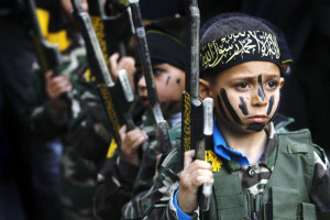 Children line up at an ISIS training camp. AP photo.