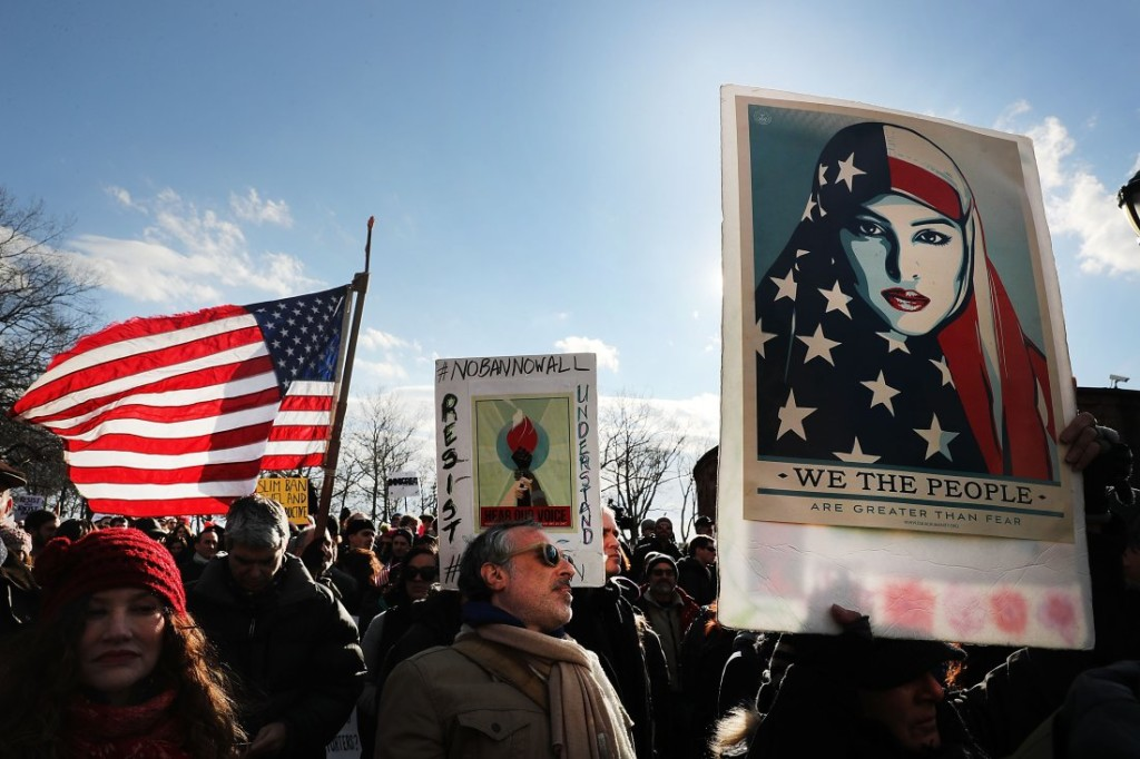 NEW YORK, NY - JANUARY 29:  People attend an afternoon rally in Battery Park to protest U.S. President Donald Trump's new immigration policies on January 29, 2017 in New York City. Trump's executive order on immigration has created chaos and confusion among many Muslims as it temporarily bars citizens from seven largely Muslim countries, as well as all refugees, from entering the U.S.  (Photo by Spencer Platt/Getty Images)